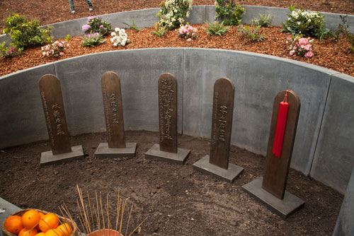 Bronze Headstones with Chinese Characters at the Evergreen Chinese Memorial in Santa Cruz